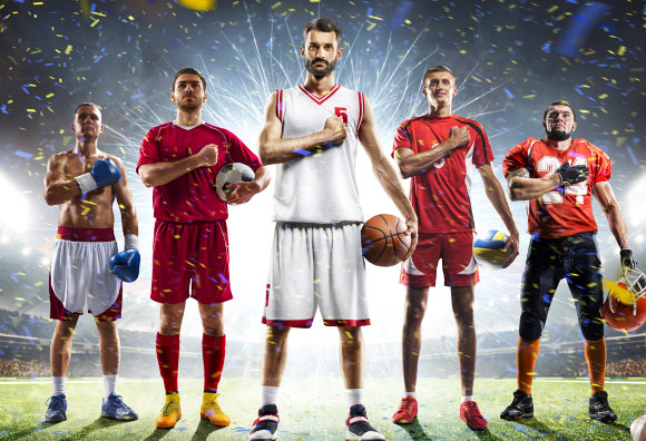 group of basketball player are standing while putting his arm right arm at the chest