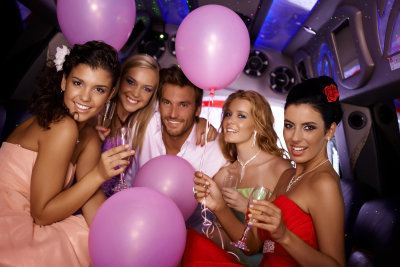 Attractive young people having party in limousine