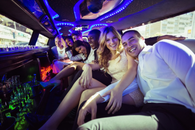 A happy people partying inside the limousine
